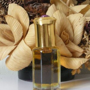 Pale yellow clear sandalwood attar